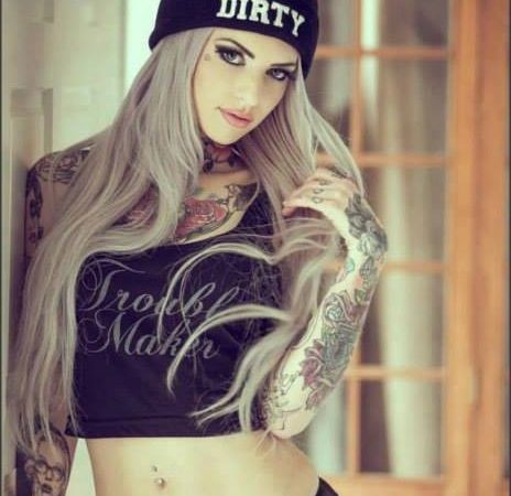 Cute girl with tattoos and beanie