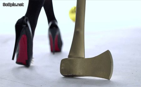 Gril in black high heels with an axe