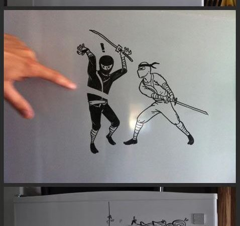 artist draws images on his refrigerator
